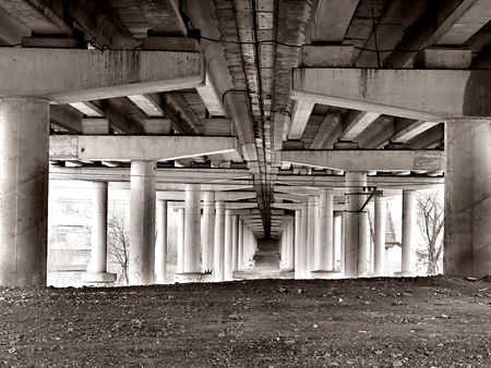 bottom view of a concrete bridge in grunge style photo