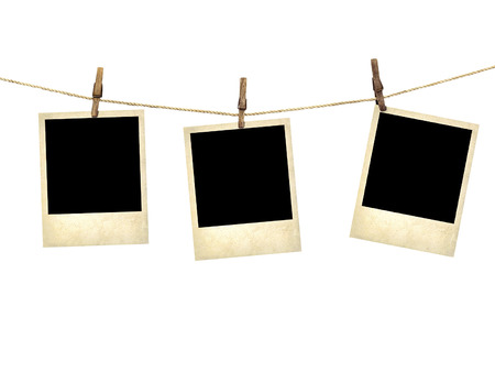 Old style photographs  hanging on a clothesline isolated on white background