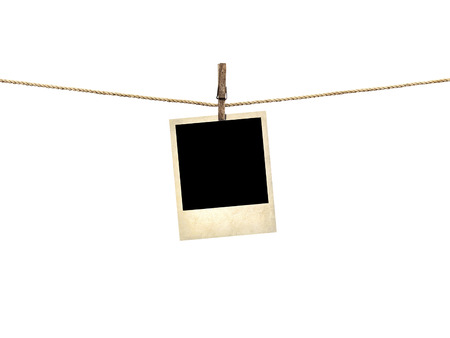 Old style photo  hanging on a clothesline isolated on white background photo