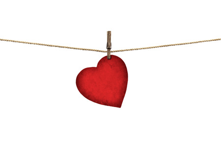 Valentine card heart shaped from old red paper hanging on a clothesline isolated on white background