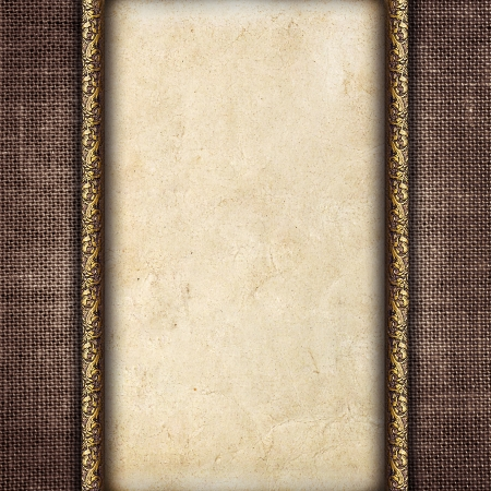 Vintage card in a carved frame on fabric background photo