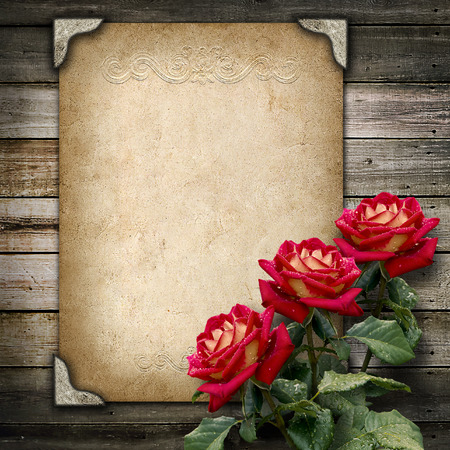 Old vintage frame for photos and a bouquet of red  roses Stock Photo