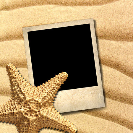 Photo of an old style decorated starfish on a background of sea sand photo