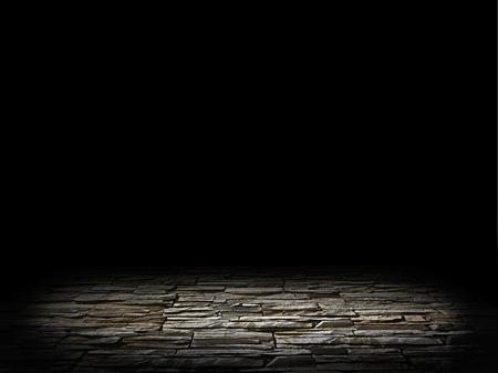 verlichte stenen vloer op een zwarte achtergrond Stockfoto