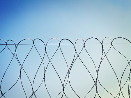 unfreedom: spirals of barbed wire against the sky