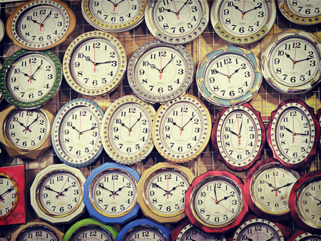 wall clock: Many different wall clock on the wall