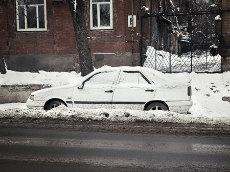 car in the snow on the roadside photo