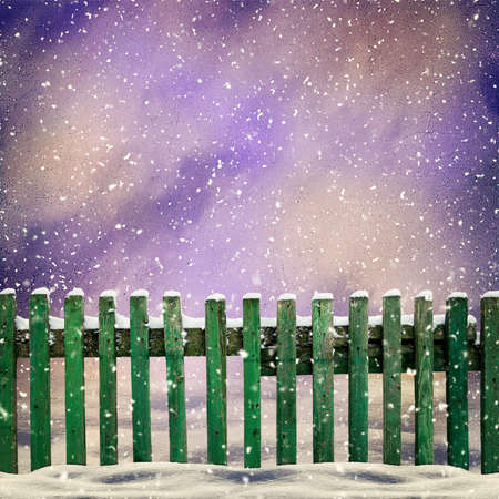 snowfalls: snowy old green wooden fence and falling snow