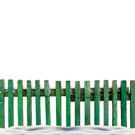 isolaten: snowy old green wooden fence isolaten on white background Stock Photo