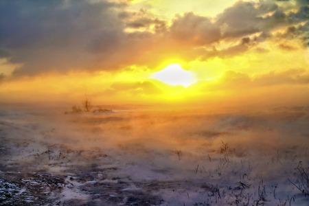 desert storm: snow storm in the desert at sunset Stock Photo