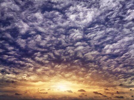setting  sun: setting sun among the curly rain clouds