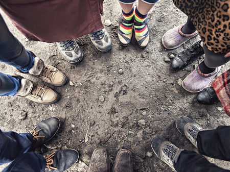 round: feet of people standing in a circle
