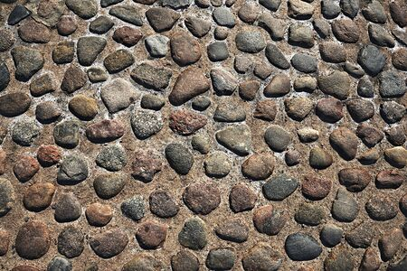 cobbles: grunge old stone cobbles as a background Stock Photo