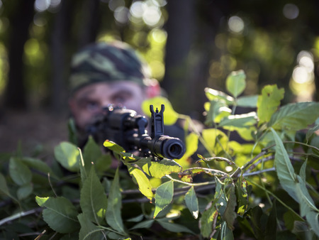 ambush: soldier shooting from an   ambush Stock Photo