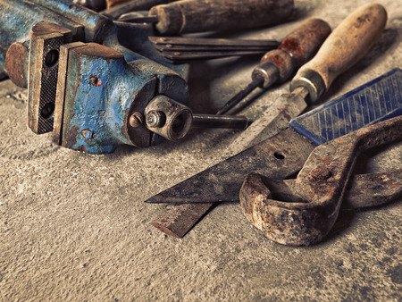working hands: set of old dirty tools in vintage style