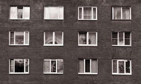 multistory: black and white windows of the old multistory building