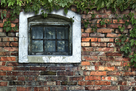 Old brick wall with wooden window in the background in grunge style