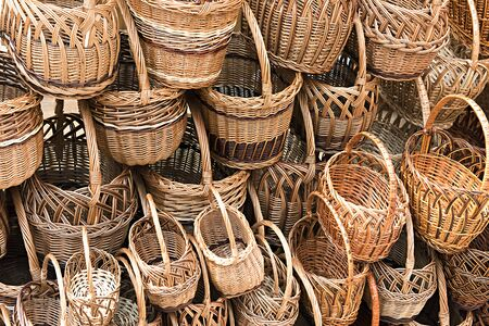 many different wicker baskets as a background