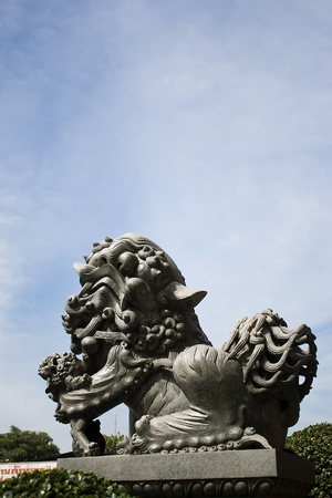 stone lion  with blue sky background