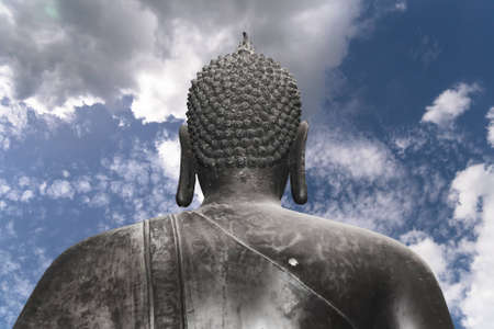 Buddha back in clear sky