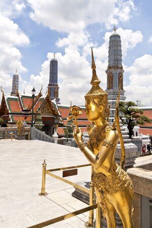 Kinnalee (mythical creature, half bird, half man), the Wat Phra Kaew and the Grand Palace in Bangkok. This picture taken on sunny days. Note that there is a cloud. Stock Photo - 13492058