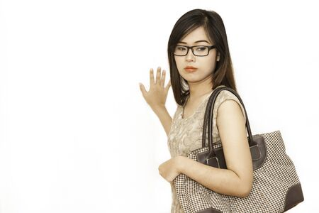 Asian young beautiful girl with fashion bag isolated  photo