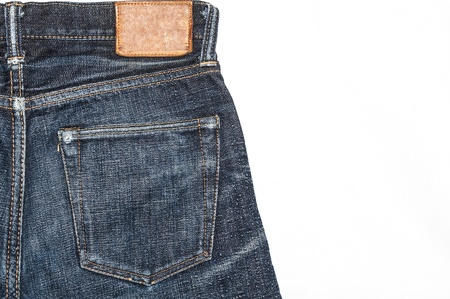 Leather jeans label sewed on a blue jeans. Stock Photo - 16827820