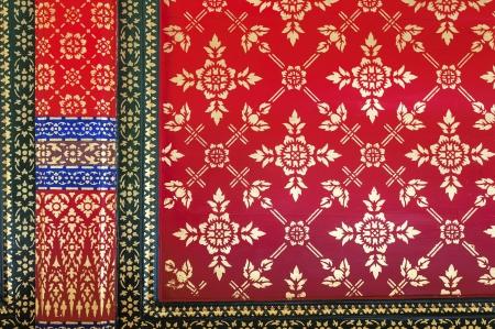 Golden Line thai on red background photo