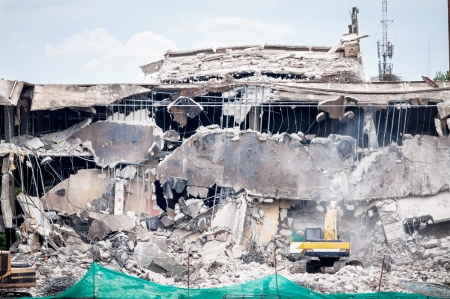 demolished: Building Destroyed by yellow backhold   Stock Photo