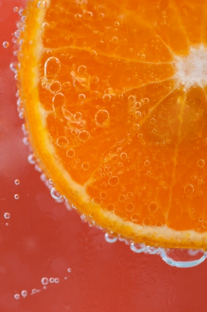 Orange slice and water droplets photo