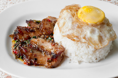 Rice with stir fried hot and spicy pork with basil  photo