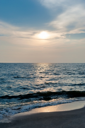 generic location: sunsetsea sand sun Stock Photo