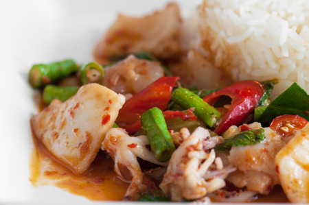 Rice with stir fried hot and spicy squid with basil  photo