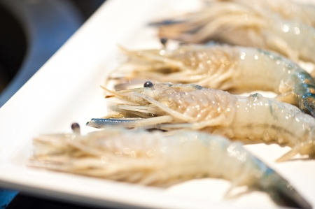Pile of Shrimp in white dish .