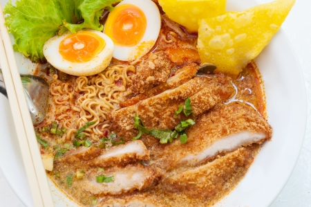 Pork noodle tom yum, condensed water egg. Stock Photo