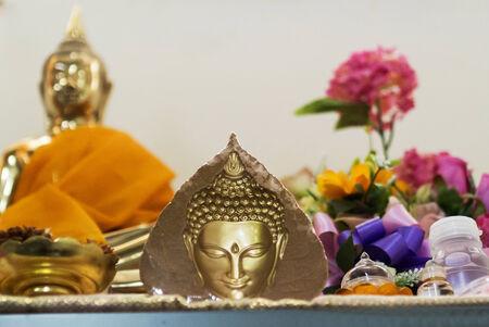 Golden leaf buddha and sit buddha . photo