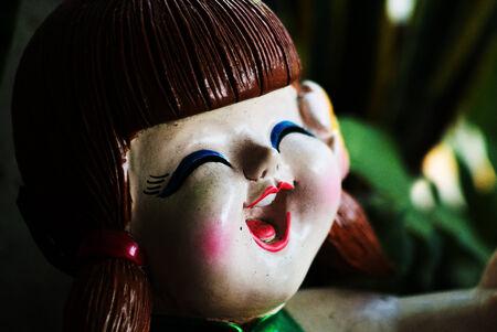 diabolic: Antique doll smile still life . Stock Photo