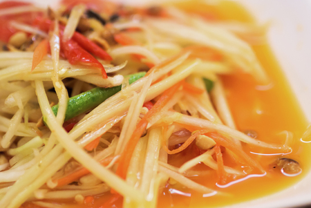 papaya salad with horse crab close up .
