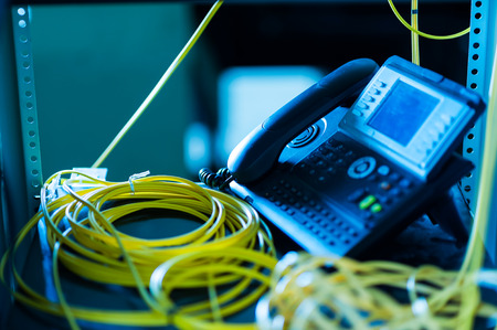 ip: IP phone in network room .