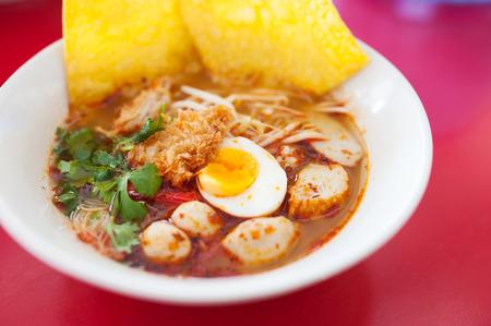 tom': Pork noodle tom yum, condensed water egg .