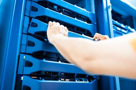 People fix server network in data room .
