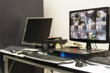 security monitor: An Cctv monitor in security room center . Stock Photo