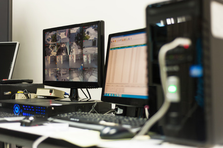 An Cctv monitor in security room center . Stock Photo