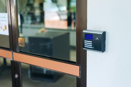 Security door card scan in soft light .