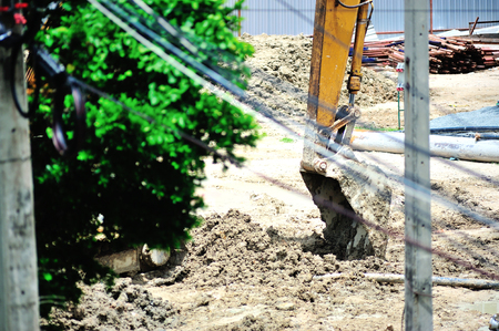 tree works: An excavator on a construction site .