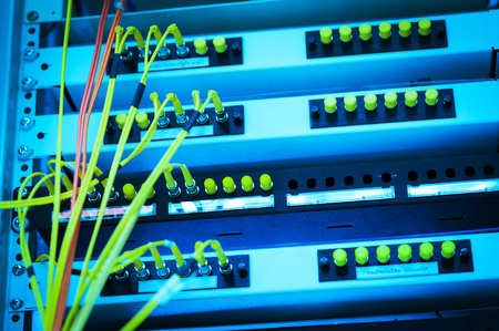 hub computer: fiber optic with servers in a technology data center . Stock Photo