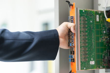 plugging: Fix network switch in data center room . Stock Photo