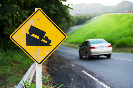 danger ahead: An Steep sign symbol warning dangerous . Stock Photo
