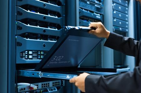 server: Man fix server network in data center room .
