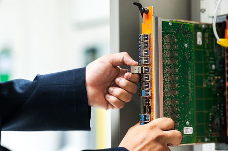 Fix network switch in data center room . Stock Photo